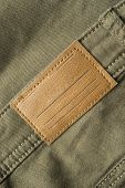 pic of khakis  - Blank leather label on khaki pants closeup as a background - JPG
