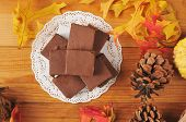 stock photo of doilies  - Delicious squares of fudge on a doily photographed from a high angle - JPG