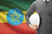 foto of ethiopia  - Architect with flag on background  - JPG