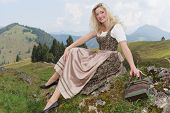 pic of bavarian alps  - Young Bavarian woman in dirndl fashion - JPG