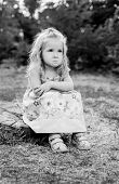 picture of pain-tree  - cute little girl for a walk upset sitting on a tree stump  - JPG