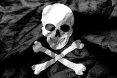 picture of skull crossbones flag  - Skull and crossbones flag texture crumpled up - JPG