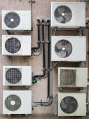 stock photo of air compressor  - Eight air compressors in rows with pipe and fan - JPG