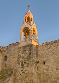 picture of repentance  - Holy Church Of The Nativity bell tower glows in the late afternoon sun - JPG