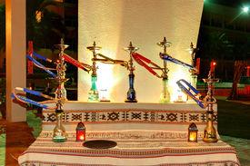 stock photo of shisha  - The Shisha smoking area at the luxury hotel in night illumination Fujairah UAE - JPG