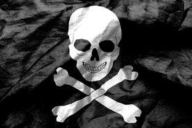 image of skull crossbones flag  - Skull and crossbones flag texture crumpled up - JPG
