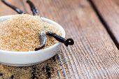 stock photo of vanilla  - Vanilla Sugar (Brown) on wooden background (close-up shot) ** Note: Shallow depth of field - JPG
