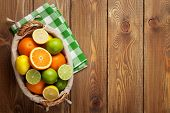 foto of wooden basket  - Citrus fruits in basket - JPG