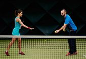 foto of  practices  - Woman player and her coach practicing on a tennis court - JPG