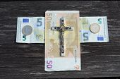 stock photo of crucifixion  - euro money cross and metal crucifixion with Jesus concept - JPG
