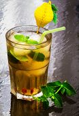 stock photo of flavor  - iced green tea flavored with mint and iced cubes - JPG
