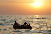 pic of raft  - People on the raft with sea - JPG