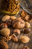image of nutcracker  - steel nutcracker and nuts of various kinds nuts in honey - JPG
