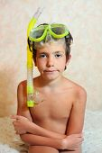 stock photo of nymphet  - handsome preteen boy with snorkeling mask and tube - JPG