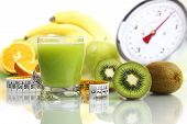 stock photo of fruit-juice  - kiwi juice in glass fruit meter scales diet food - JPG