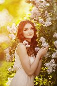 stock photo of allergy  - Young spring fashion woman  in spring garden - JPG