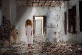 picture of possess  - ghost woman in abandoned house NOTE TO REVIEWER SPECIAL MOOD LIGHTING FOR DRAMATIC EFFECT  - JPG