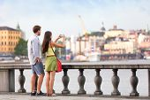 stock photo of city hall  - Europe travel tourist people taking pictures - JPG