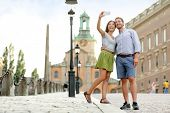 image of royal palace  - Selfie couple taking pictures at Stockholm cathedral and royal palace in Gamla Stan  - JPG