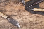 foto of leather tool  - old vintage leather tools on the table - JPG