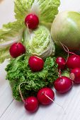foto of radish  - Set for salad from a radish radish and lettuce - JPG