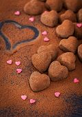pic of truffle  - Heart shaped chocolate truffles on cocoa powdered table Valentine concept
