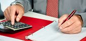 picture of accounting  - Hands of accountant business man with calculator - JPG