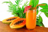 picture of papaya fruit  - papaya fruit and glass of juice and exotic leaves - JPG