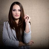 picture of canvas  - portrait of beautiful young woman indoor over canvas - JPG