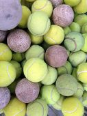 pic of softball  - Tennis ball with softball in iron basket - JPG