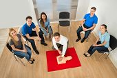stock photo of first class  - Elevated View Of First Aid Instructor Showing Resuscitation Technique On Dummy - JPG