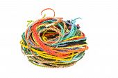 stock photo of mulberry  - colorful rope made from mulberry paper on white background - JPG