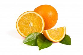 stock photo of half  - Whole orange half an orange orange slice in the peel on the green leaves on a white background - JPG