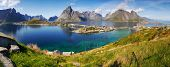 stock photo of reining  - Panorama beautiful sea bays with high mountains around the village of Reine - JPG