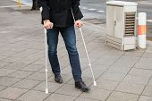 image of crutch  - Man Trying To Walk On Street With The Help Crutches - JPG