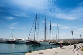 picture of piraeus  - Luxury yachts and sailboats and  small fishing boats in the small harbour of Zeas - JPG