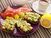 picture of avocado  - Avocado toasts with prosciutto shot from above - JPG