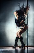 stock photo of pole dancer  - Young beautiful sexy pole dance woman  - JPG