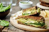 stock photo of avocado  - grilled rye sandwiches with cheese spinach pesto avocado and goat cheese - JPG