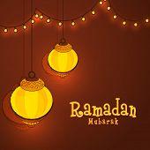 image of ramadan mubarak card  - Beautiful illuminated lanterns with glowing lights on brown background - JPG