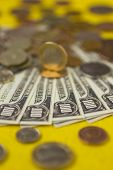stock photo of copper coins  - Banknotes and coins on table close up  - JPG