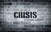picture of isis  - Crisis stencil print on the grunge white brick wall - JPG
