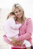 image of cuddle  - Mother Cuddling Young Daughter outdoors - JPG