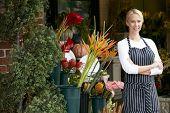 foto of flower shop  - Portrait Of Female Florist Outside Shop - JPG