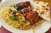 picture of tamarind  - Indian tandoori chicken with fresh naan and tamarind rice  - JPG