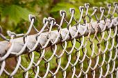 foto of chain link fence  - Selective focus on a chain link fence at a park - JPG