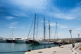 image of piraeus  - Luxury yachts and sailboats and  small fishing boats in the small harbour of Zeas - JPG