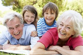 picture of grandparent child  - Grandparents And Grandchildren In Park Together - JPG