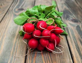 foto of radish  - Fresh organic radish on a old wooden background - JPG