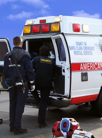 image of hospital patient  - A photo of an ambulance with patient inside - JPG
